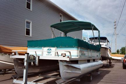 Pontoon Boat Tonneau Cover Featuring a Bimini Top