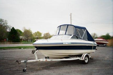 Bimini Top with Three Piece Windshield and Side Windows Complimented with Canvas Aft Cover