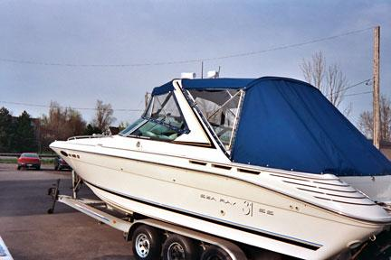 Blue Bimini Top with Two Piece Windshield & Side Windows with a Custom Aft Cover