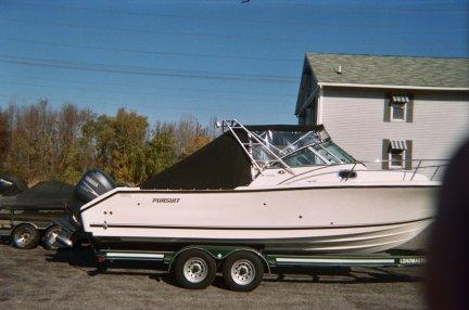 Black Bimini Top with Three Piece Windshield and Side Windows Finished with a Secure Aft Cover