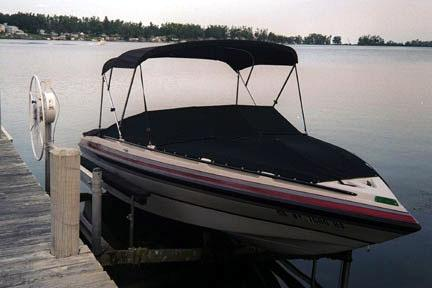 Black Bimini Top with Over The Windshiled Tonneau Cover and Bow Cover